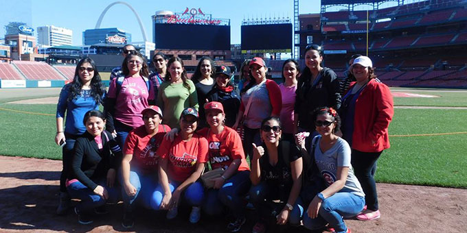 group of students on the St. Louis Cardinals field